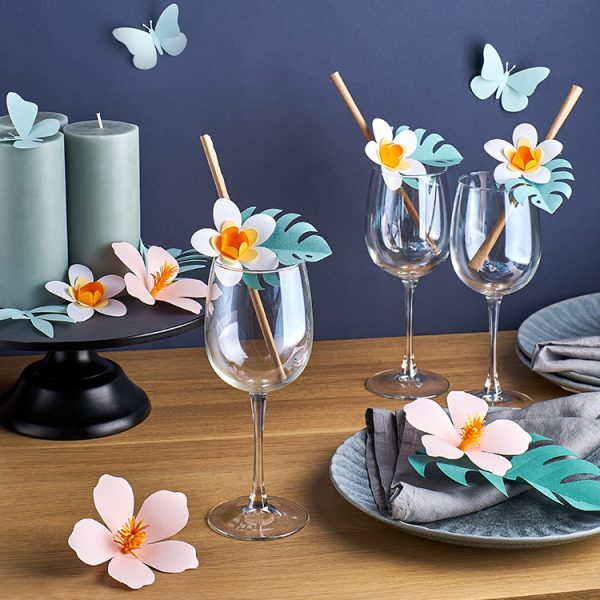 Tropical paper flowers and butterflies party decor